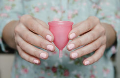 Close up of woman hands holding menstrual cup Royalty Free Stock Photo