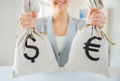 Close up of woman hands holding money bags Stock Photo