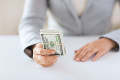 Close up of woman hands holding us dollar money Stock Image