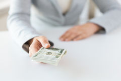 Close up of woman hands holding us dollar money Stock Photography
