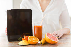 Close up of woman hands with juice and fruits Stock Images