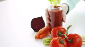 Close up of woman hands with juice and vegetables stock video
