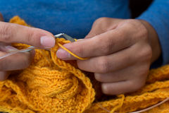 Close up of woman hands knitting colorful wool yarn Royalty Free Stock Photos