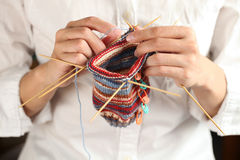 Close up of woman hands knitting stock images