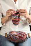 Close up of woman hands knitting stock photography