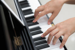 Close up of woman hands  playing piano background Stock Photography