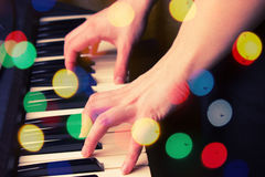 Close up of woman hands playing piano Royalty Free Stock Photography