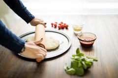 Woman preparing pizza Royalty Free Stock Images