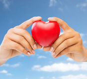 Close up of woman hands with red heart Stock Photos