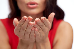 Close up of woman hands sending blow kiss. People and gesture concept - close up of woman hands sending blow kiss Royalty Free Stock Photography