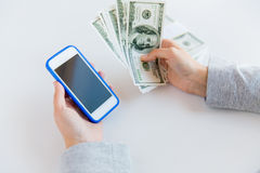 Close up of woman hands with smartphone and money Stock Images