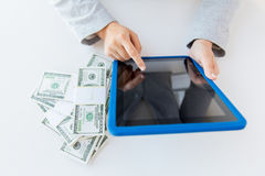 Close up of woman hands with tablet pc and money Stock Photos