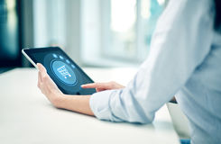 Close up of woman hands with tablet pc at office Stock Images