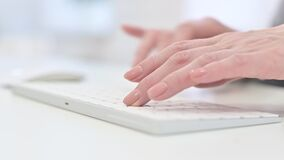 Close up of woman hands typing on keyboard