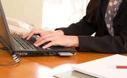 Close up of woman hands typing on laptop Royalty Free Stock Photography