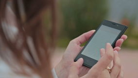 Close up of Woman Hands Using Smartphone. With Beautiful Nature on the Background stock video footage