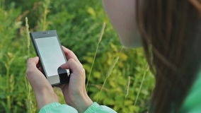 Close up of Woman Hands Using Smartphone in Beautiful Nature. Close up of Woman Hands Using Smartphone with Beautiful Nature on the Background stock video