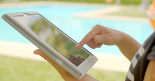 Close Up on Woman Hands While Using Tablet. In Outdoor Swimming Pool Area on Slow Motion Video stock video