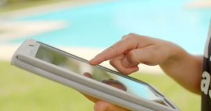 Close Up on Woman Hands While Using Tablet. In Outdoor Swimming Pool Area on Slow Motion Video stock footage