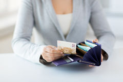 Close up of woman hands with wallet and euro money Stock Photos