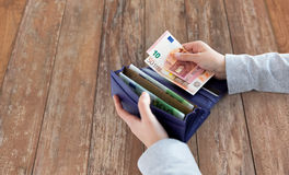Close up of woman hands with wallet and euro money Royalty Free Stock Photos
