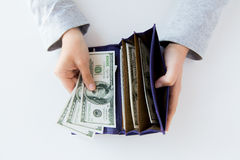 Close up of woman hands with wallet and money Stock Photography