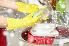 Close up of woman hands washing dishes in kitchen Royalty Free Stock Image