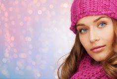 Close up of woman in hat and scarf over lights Royalty Free Stock Photos