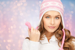 Close up of woman in hat and scarf over lights Royalty Free Stock Photography