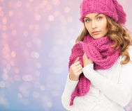 Close up of woman in hat and scarf over lights Royalty Free Stock Images
