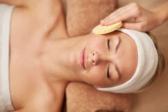 Close up of woman having face cleaning in spa Stock Images