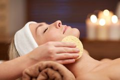 Close up of woman having face cleaning in spa Royalty Free Stock Image