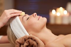 Close up of woman having face cleaning in spa Royalty Free Stock Images