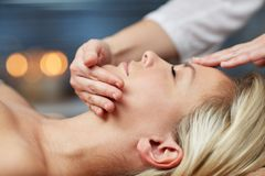 Close up of woman having face massage in spa Royalty Free Stock Photos