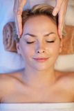 Close up of woman having face massage in spa Stock Image