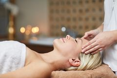 Close up of woman having face massage in spa Stock Images