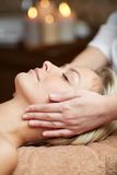 Close up of woman having face massage in spa Royalty Free Stock Image