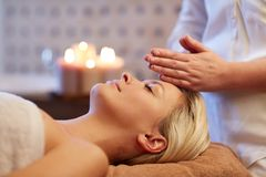Close up of woman having face massage in spa Stock Photos
