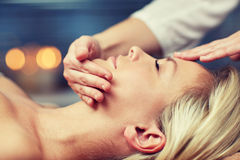 Close up of woman having face massage in spa Royalty Free Stock Images