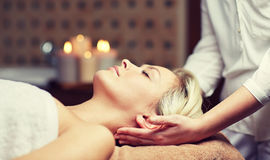 Close up of woman having face massage in spa Royalty Free Stock Photo