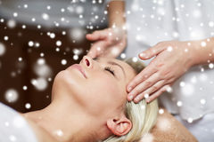 Close up of woman having face massage in spa salon Stock Photos