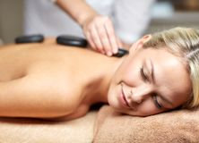 Close up of woman having hot stone massage in spa Royalty Free Stock Image