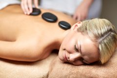 Close up of woman having hot stone massage in spa Royalty Free Stock Photos