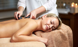 Close up of woman having hot stone massage in spa Royalty Free Stock Images