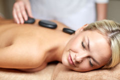 Close up of woman having hot stone massage in spa Stock Images
