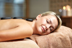 Close up of woman having hot stone massage in spa Royalty Free Stock Photography