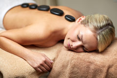 Close up of woman having hot stone massage in spa Stock Photos