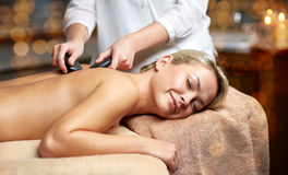 Close up of woman having hot stone massage in spa Stock Image