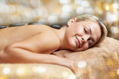 Close up of woman having hot stone massage in spa Stock Photography