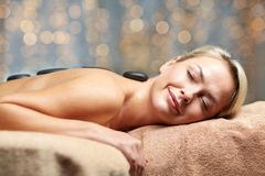 Close up of woman having hot stone massage in spa Royalty Free Stock Photo